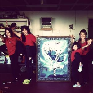 Posing with my friends with the Painting